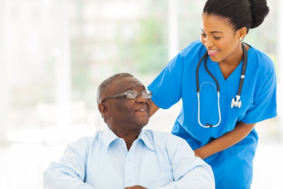 nurse smiling to a senior man