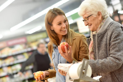 woman and senior woman buying fruits