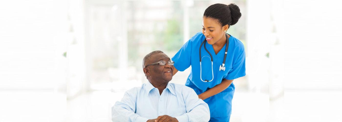 nurse smiling to a senior man